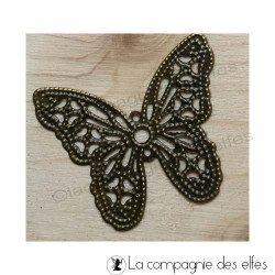 papillon métal bronze