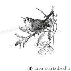un oiseau sur sa branche tampon nm